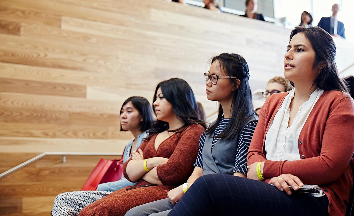 Harris students sitting together inside the Keller Center
